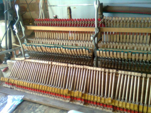 Upright piano action dissassembled