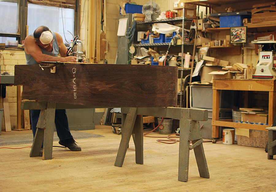 Man building a Steinway Louis XV piano